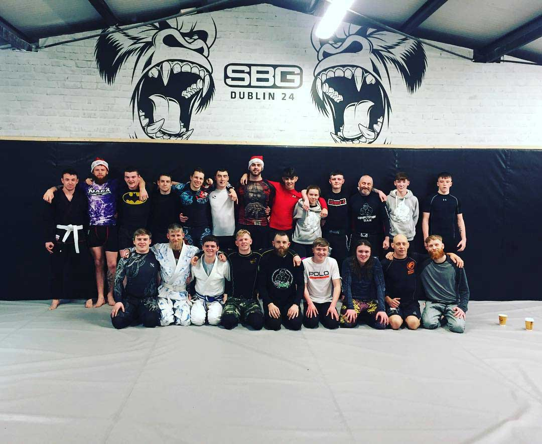 Members and coaches on the mats of SBG Dublin24 on Christmas day